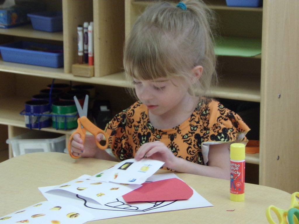 Preschooler making art project
